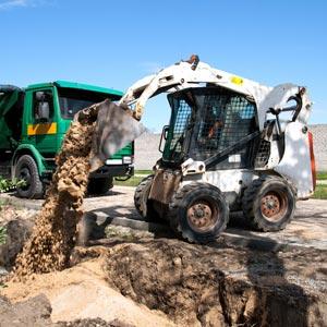 Bobcat Dumping Dirt